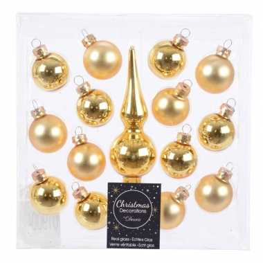Gouden glazen kerstballen en piek voor kleine kerstboom